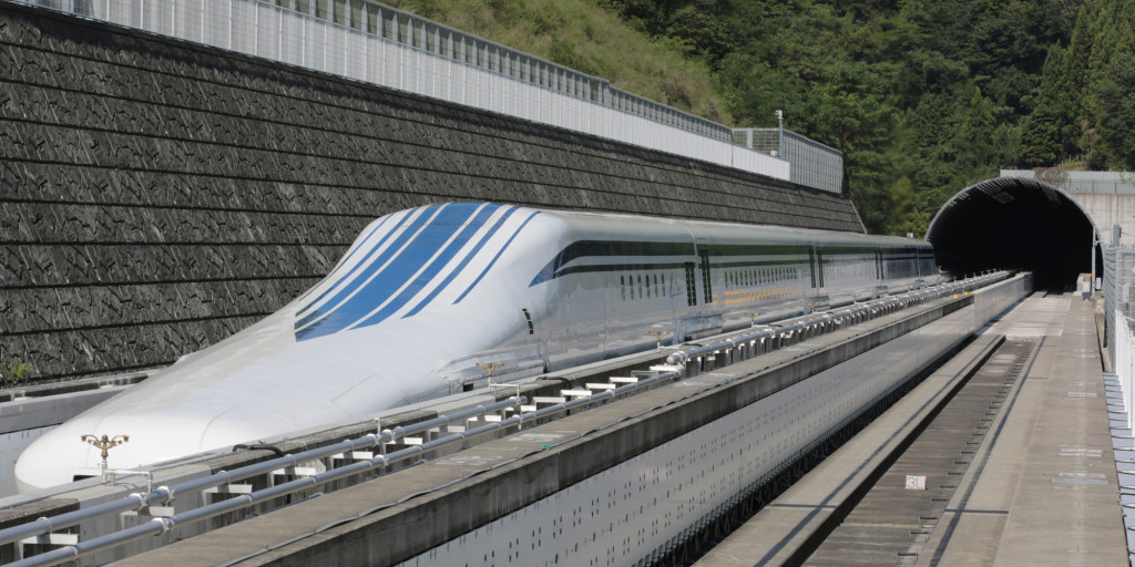 The L0 (L zero) series magnetic-levitation train, developed by Central Japan Railway Co., sits parked on a test track at the control center before a trial run in Tsuru City, Yamanashi Prefecture, Japan, on Thursday, Aug. 29, 2013. Japan resumed trial runs for the world's fastest magnetic-levitation train that will complement the Shinkansen bullet-train network when ready in 2027. Photographer: Yuriko Nakao/Bloomberg via Getty Images